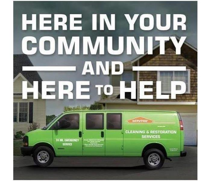 "Van with logo ""Here in your community and here to help"""